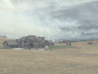 Large brush fire burning near Chatfield