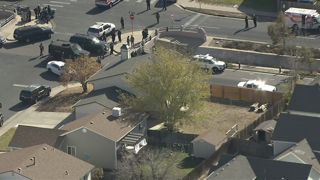 Suburban Denver officer, suspect wounded in shooting