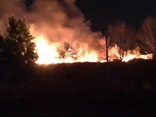 Fire burns in homeless camp in Denver
