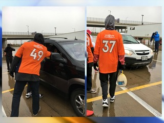 Broncos help Rescue Mission pass out meals