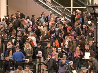 Long security lines, delays greet DIA passengers