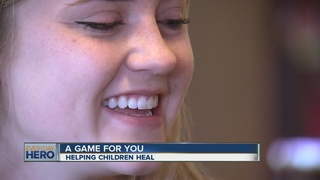 Young volunteer provides games for sick kids