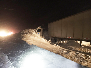 Avalanche buries semi, closes I-70 for hours