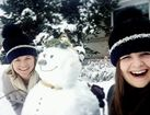 Denver residents enjoy snow, build snowmen