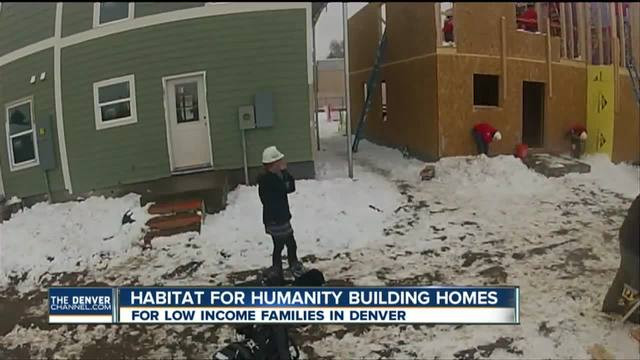 Volunteers work with Habitat for Humanity to build homes on Martin…