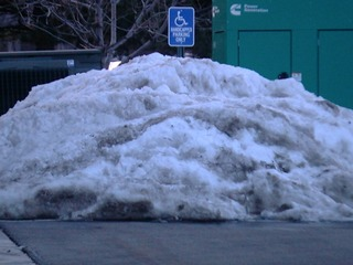 Snow piled in accessible parking at senior home