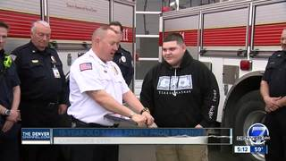 Boy honored for rescuing family from fire