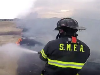 At least 1 outbuilding burned in Watkins fire