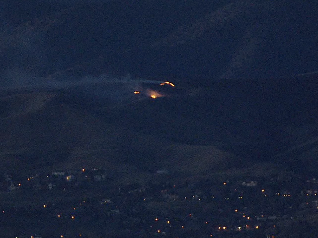 Crews battle brush fire on Green Mountain