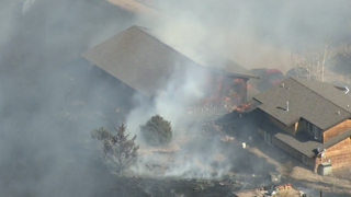 Another brush fire sets buildings on fire in CO