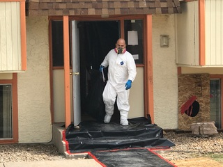 Corpse found in flooded CO apartment complex