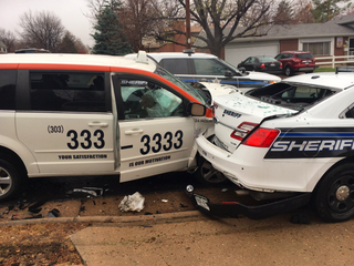 DUI suspected after taxi slams into patrol car