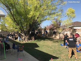 Investigators search Pueblo home in cold case