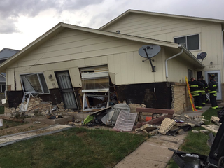 1 injured after car crashes into home