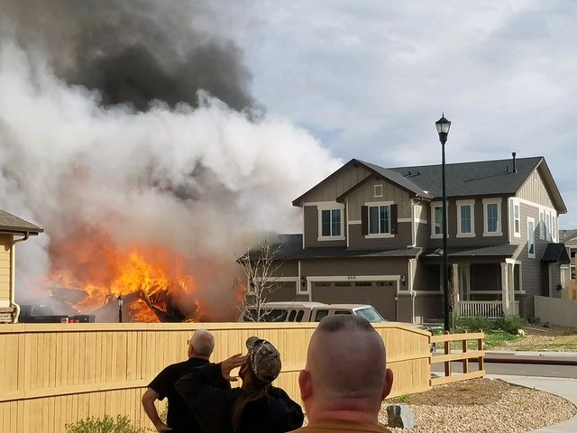 Two injured in reported explosion- fire at Firestone home