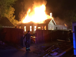 Home engulfed in flames as firefighters arrive