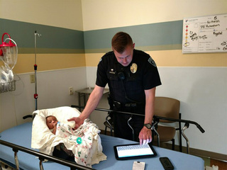 Thornton PD officer snapped taking care of baby