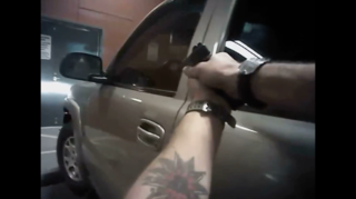 Body Cam: Police draw guns, pull man out of car