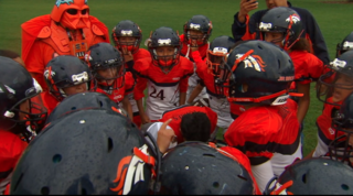 Orange Vader helps coach youth football team