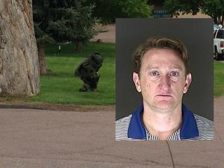 Teacher, son arrested for Springs smoke bomb
