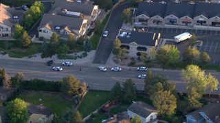 Centennial carjacking suspect dead, 2 at-large