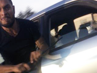 Baton-wielding man sought in roadside brawl