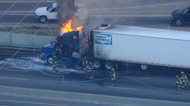 Semi-truck fire off EB Interstate 70 at York Street