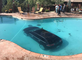 Woman drives car into pool in Colorado Springs