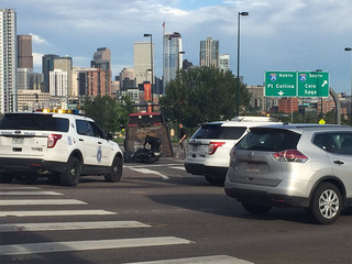 DPD officer hit, hurt trying to stop motorcycles
