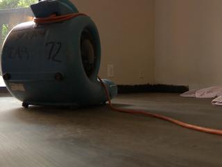 Woman says apt. gave her flood-prone unit