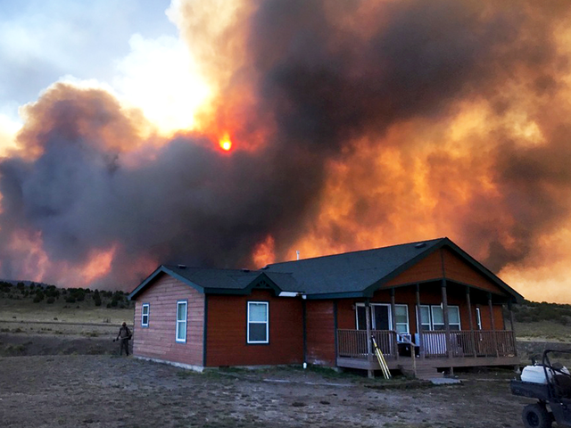 Wildfire threatening homes, oil/gas structures