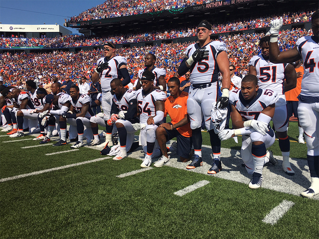 Broncos kneel, lock arms and raise fists following President Trump's remarks about 'firing' players