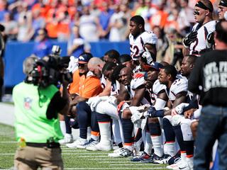 Photos: Broncos protest Trump's NLF remarks