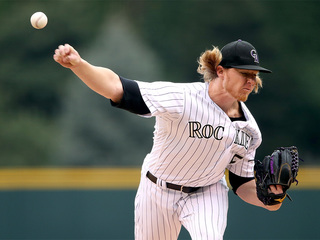 Rockies defeat Marlins at Coors Field 15-9