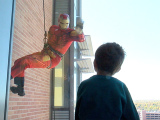 Superheroes rappel down Aurora hospital for kids