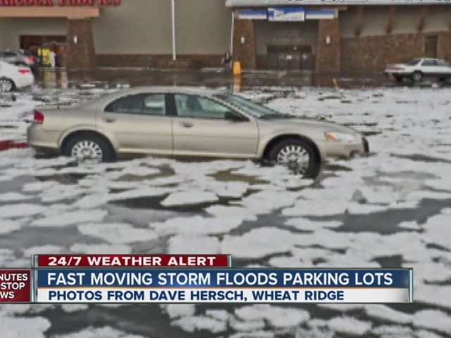 Hail storm causes flooding, blocks roads