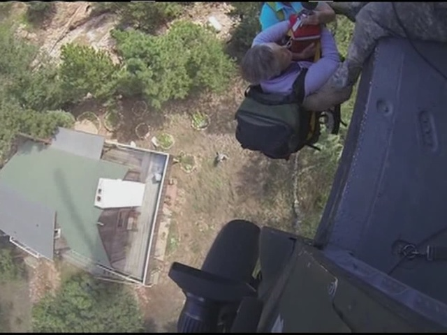 Raw Video: People plucked from home bu National Guard