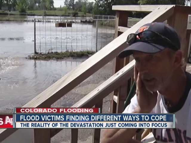 Flood victim's 'Lakefront Property For Sale' sign helps him cope