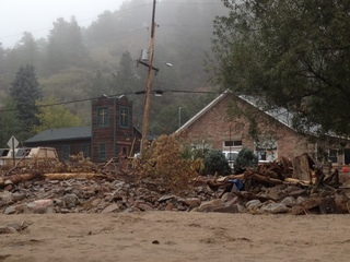 Mountain towns still rebuilding after floods