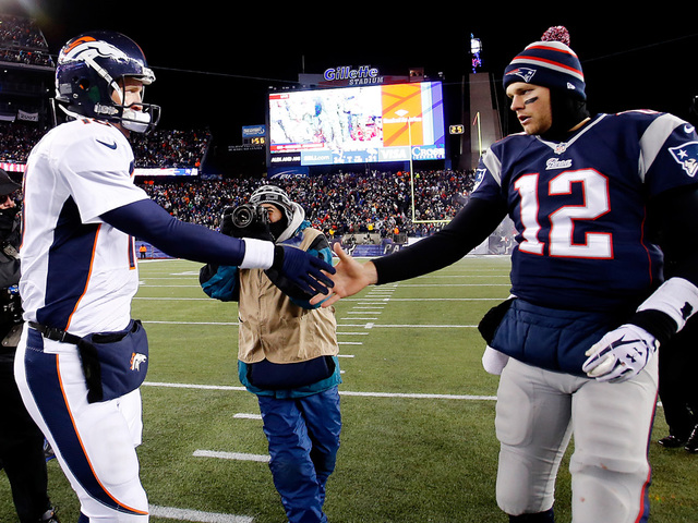 Peyton manning tom brady to meet in afc championship in denver foxboro ma november 24 quarterback peyton manning 18 of the denver broncos and quarterback tom brady 12 of the new england patriots shake hands after m4hsunfo