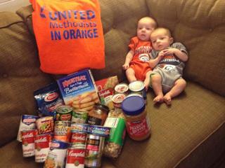 Denver challenges Charlotte to food drive