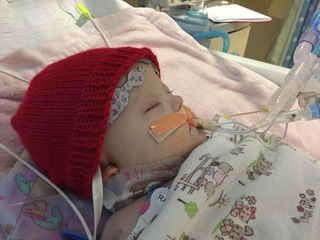 Raising heart defect awareness with babies' hats