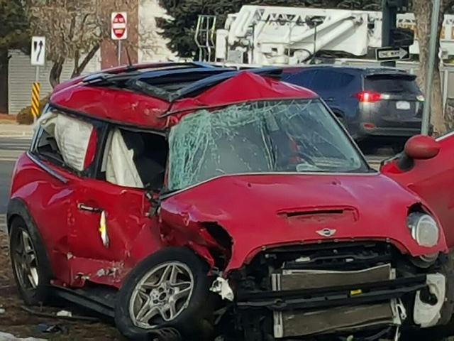 Damage Done To Red Mini Cooper Involved In Crash With Denver Fire Truck Photo Keith Balka