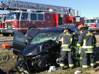 Head-on car crash: 2 dead, 2 hurt in Aurora