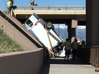 Van flies off elevated part of I-25