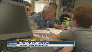 Retired teacher helping students learn math