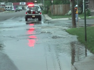 Water gushes down street after water main break