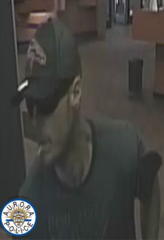 Man wanted in Aurora U.S. Bank robbery