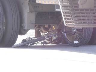 Teen on bicycle hurt in collision with semi