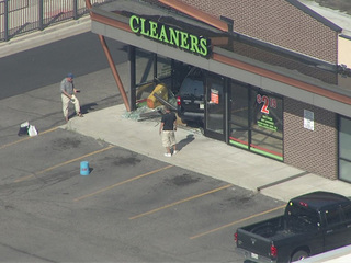 SUV slams into Impressive Cleaners on E. Hampden